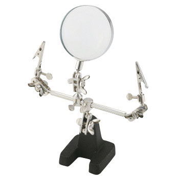 A Stand Magnifying Glass With A Clip